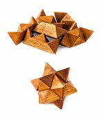 stock photo of dodecahedron  - Rhombic dodecahedron wooden puzzle isolated on white from start to end - JPG