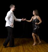 picture of ballroom dancing  - couple dancing salsa in the middle of a pose