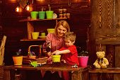 Mothers Day Concept. Mother And Little Son Potting Flower On Mothers Day. Mother And Child Replant F poster