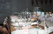 Empty Glasses In Restaurant. Cutlery On The Table In A Restaurant Table Setting, Knife, Fork, Spoon, poster
