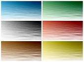 Red, Blue, Green, Black, Yellow And Brown Water Level. Beautiful Water Background For Your Project.