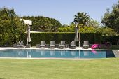 Luxury resort swimming pool with gray chairs