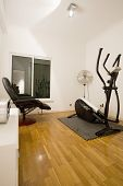 home gymnasium with television in mansion private residence