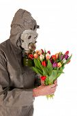 Man dressed in protection suit and gas mask with bouquet flowers