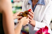 Female pharmacist consulting a female customer in her pharmacy