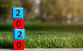 2020 Pillar Wooden Blocks Standing On Sunflare In Park, Copy Space, Panorama poster