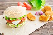 Delicious Fast Food. Homemade Hamburger. Large. Homemade, Beef Hamburger With Cheese And Vegetables. poster