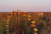 Ferris Wheel In The City Of Pripyat At Sunset Time. Apocalyptic City Of Pripyat After A Nuclear Expl poster