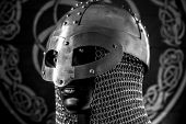 Costume Vikings, viking helmet with chain mail on a red shield with golden shapes of sun, weapons fo poster