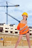 beautiful half naked woman posing on a construction site