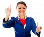 Flight attendant pointing two destinations - isolated over a white background poster