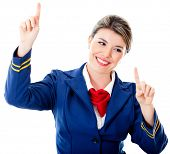 Flight attendant touching an imaginary screen with her fingers