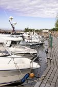 Docked Boats. Moored Boats. Boats Standing In A Row At A Wooden Pier. Docked Boats poster