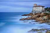 stock photo of winter palace  - Boccale castle landmark on cliff rock and sea in winter - JPG