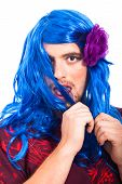 image of cross-dressing  - Bizarre transvestite cross dressing in blue wig isolated on white background - JPG