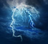 stock photo of bolt  - Powerful intelligence with an electric lightning bolt strike in the shape of a human head illuminated on a storm cloud night sky as a brain function neurology health care symbol - JPG