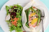 image of grated radish  - Fresh sockeye salmon poached in parchment with lemon capers green beans and salad greens - JPG