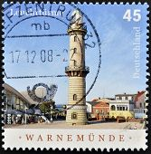 A stamp printed in Germany shows Warnemunde lighthouse