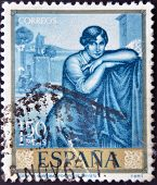 SPAIN - CIRCA 1964: A stamp printed in spain shows a painting by Julio Romero de Torres circa 1964