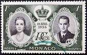 MONACO - CIRCA 1956: stamp printed in Monaco shows Princess Grace and Prince Rainier III circa 1956