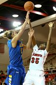 JAMAICA, NY-JAN 2: Delaware Blue Hens guard Elena Delle Donne (11) shoots over St. John's Red Storm guard Shenneika Smith (35) at Carnesecca Arena on January 2, 2013 in Jamaica, Queens, New York.