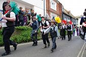 HASTINGS, ENGLAND - MAY 7: People dressed as sweeps parade through the Old Town at the Jack In The G