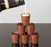Stack Of Chocolate Cups With Liqueur