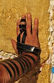 picture of phylacteries  - closeup of a hand with phylacteries at the wailing wall in Jerusalem - JPG