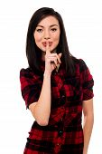 picture of shh  - Beautiful young asian girl with finger on her lips gesturing shh - JPG
