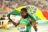BARCELONA - JULY, 14: Muktar Edris of Ethiopia celebrates his victory on 5000 meters of the 20th World Junior Athletics Championships at the Olympic Stadium on July 14, 2012 in Barcelona, Spain
