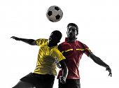 two men soccer player playing football competition fighting for a ball in silhouette on white backgr