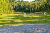 stock photo of shooting-range  - Outdoor shooting rifles range with targets at different distances - JPG