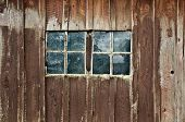 Old wooden barn with double windows