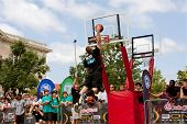 Man Elevates Above Rim In Outdoor Street Slam Dunk Contest