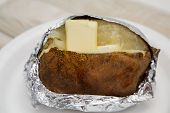 Baked Potato In Foil With Butter