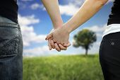 pic of holding hands  - Photo of couple holds hands on a road - JPG