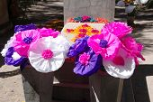 Paper flowers on grave