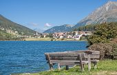 stock photo of south tyrol  - Lake Haidersee and Saint Valentin auf der Haide at Reschenpass - JPG