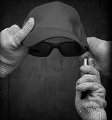 Incognito Personification With Cotton Gloves, Glasses, Baseball Cap And Mobile Phone