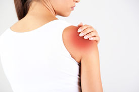stock photo of shoulder-blade  - Pain in blades the girl on gray background - JPG