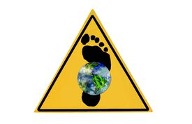 stock photo of stewardship  - A yellow warning sign with the world and a footprint - JPG