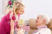 stock photo of polite girl  - Close up of smilening granddaughter with her grandma - JPG