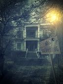 stock photo of abandoned house  - old abandoned  Scary Haunted house with no trespassing sign - JPG
