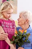 foto of grandma  - Little girl visiting grandma on grandma - JPG