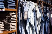 stock photo of wardrobe  - Fashion clothes on the shelves in the store - JPG