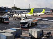 Air Baltic Airplanes In Riga Airport. Air Baltic Is The Latvian Flag Carrier Airline And A Low-cost