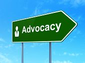 Law concept: Advocacy and Business Man on road sign background