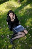 Young Lady With A Notebook In A Park