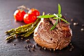 foto of ribeye steak  - Piece of red meat steak with vegetable and herbs - JPG