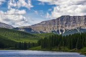 Tranquil lake in the pristine Alberta wilderness.
